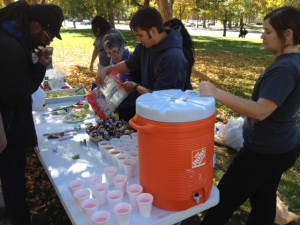 Serving up some more candy along with lemonade and apple cider at the end of the serving line at lunch in the park.