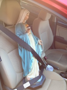 Mary is riding shotgun in my car.
