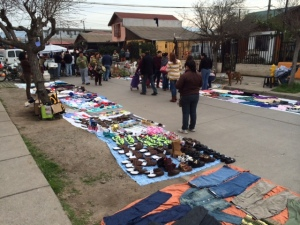 Vendors show off their goods at the fair outside the parish in Maipu.