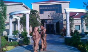 The main entrance to the Spiritual Life Center, featuring a collection of statues depicting the wedding at Cana.